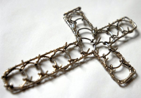 A cross-shaped cilice made of metal complete with traditional manila rope tie-cord-0