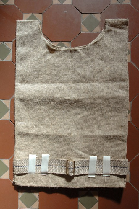 A traditional sack-cloth hairshirt with belt and metal buckle-82