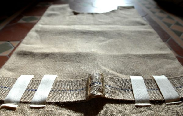 A traditional sack-cloth hairshirt with belt and metal buckle-83