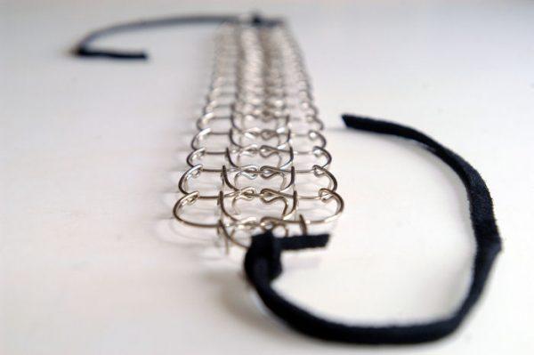A three link, 1mm gauge half-leg metal cilice with suede tie-cord-12